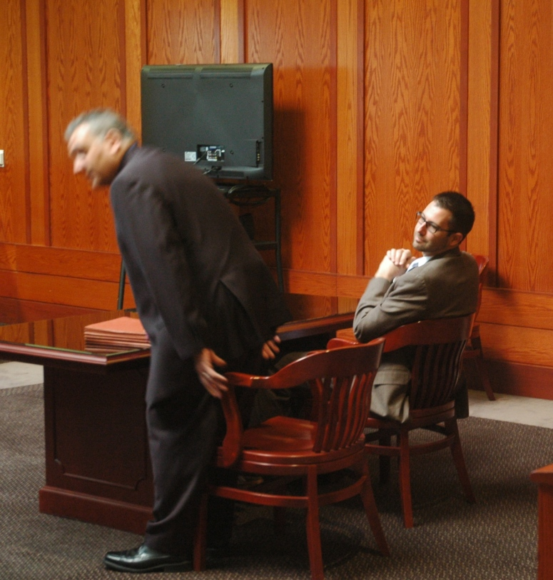 Pat Davis, (R) is seen smirking during one of many court appearances for his DWI offense in 2013.   Photo was taken in March of 2014 by Jim Spiri